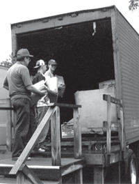 Loading newspapers during an Applegate Paper-Drive Fundraiser.